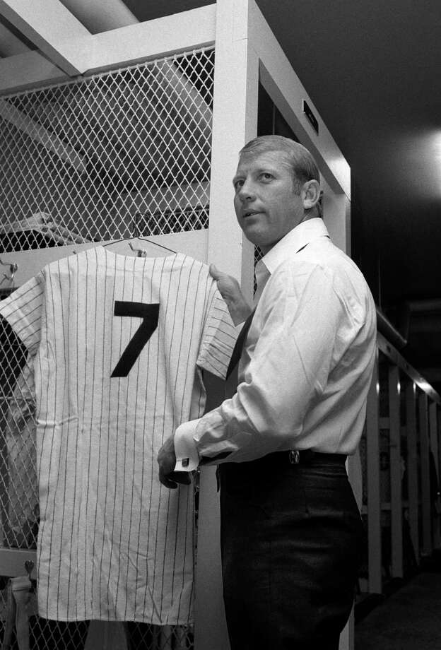 Mickey Mantle hangs up his uniform in the Yankee Stadium locker room on Mickey Mantle Day, June 8, 1969. The Yankees retired his number 7 on this day. Photo: THE ASSOCIATED PRESS FILE PHOTO   / AP1969