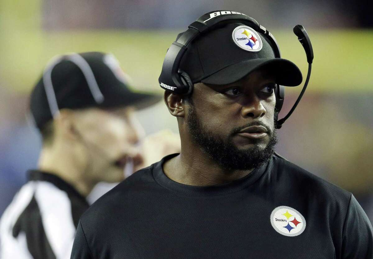 Steelers head coach Mike Tomlin watches action from the sideline in the first half of Thursday's game in Foxborough, Mass.