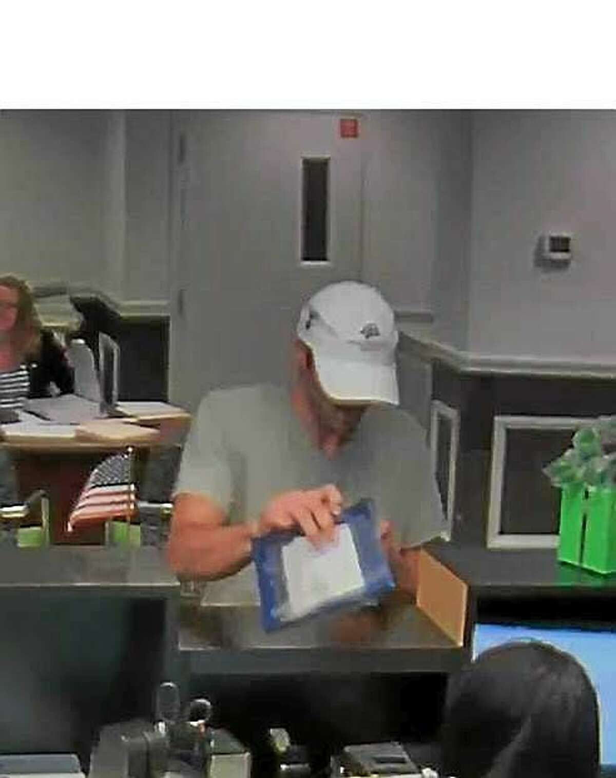 Police are looking for this man, who they say was involved in a robbery at TD Bank Friday night.