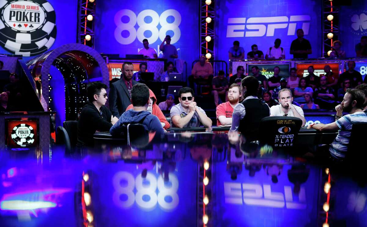 In this July 14, 2015 photo, players compete at the World Series of Poker main event in Las Vegas.