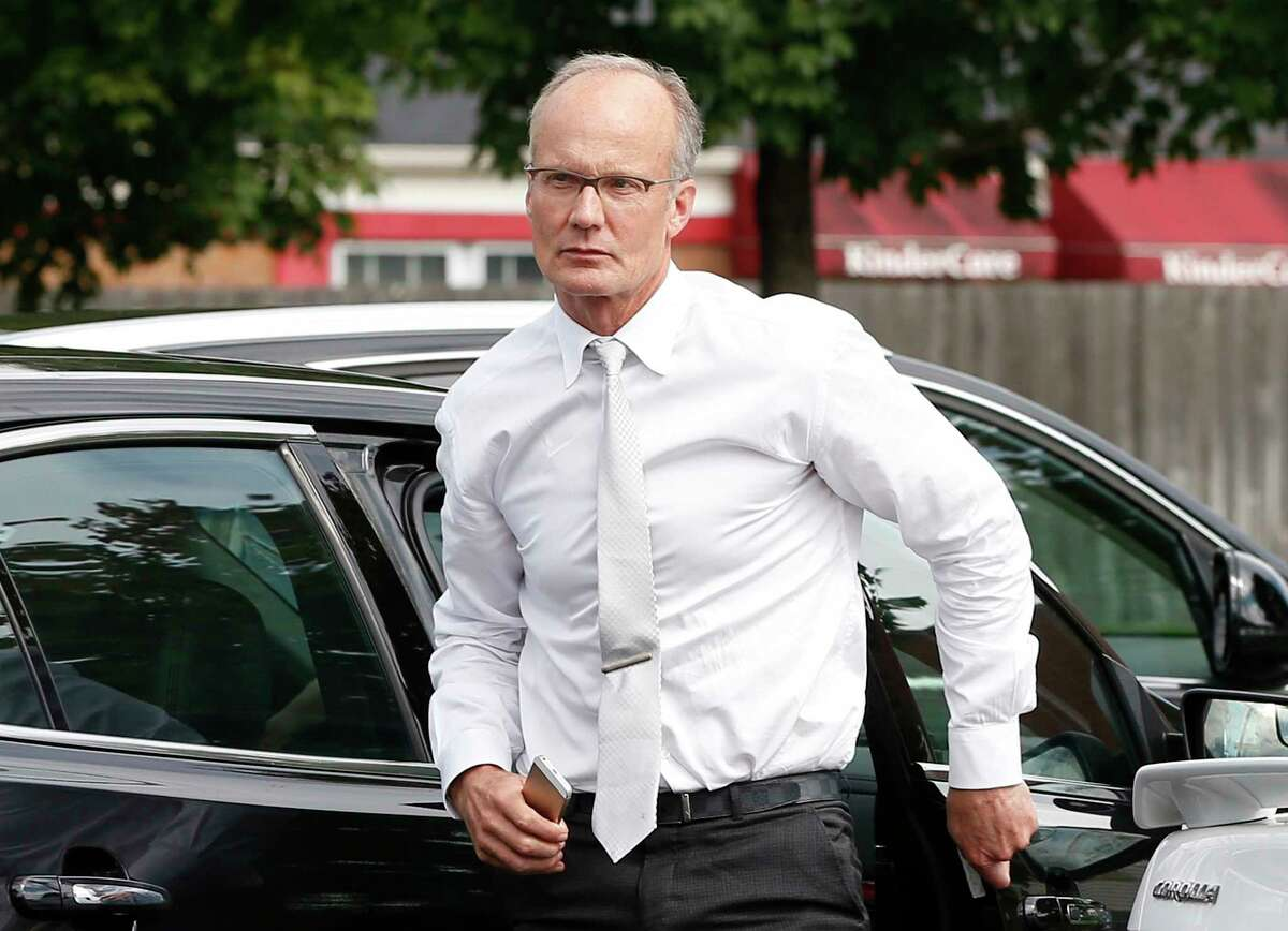 In this Sept. 8 file photo, dentist Walter Palmer, arrives back at his office following a lunch break in Bloomington, Minn.