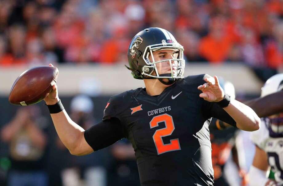 Oklahoma State quarterback Mason Rudolph. Photo: Sue Ogrocki — The Associated Press   / AP