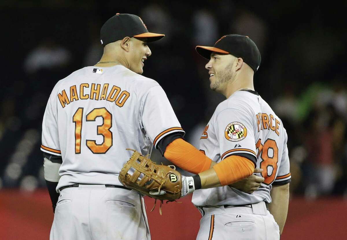 Baltimore Orioles' Manny Machado (13) and Steve Pearce (28) celebrate after a baseball game against the New York Yankees on Wednesday, Sept. 9, 2015, in New York. The Orioles won 5-3. (AP Photo/Frank Franklin II)
