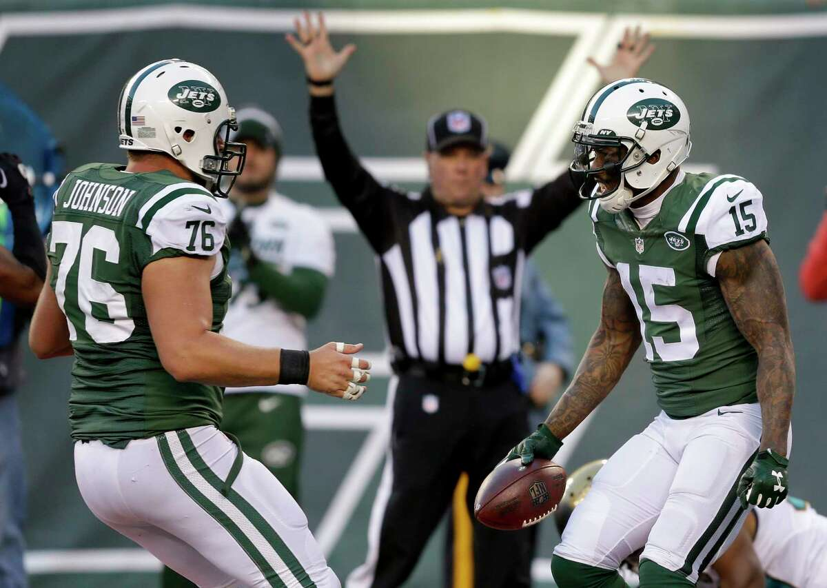 Jets wide receiver Brandon Marshall (15) celebrates with center Wesley Johnson after scoring a touchdown against Jaguars in the fourth quarter on Sunday.