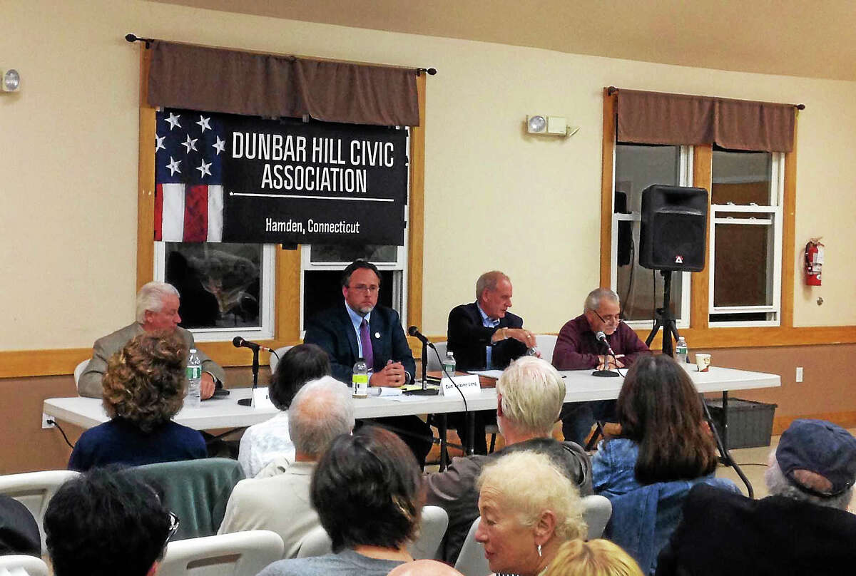 KATE RAMUNNI — NEW HAVEN REGISTER Republican mayoral candidate Bob Anthony, left, and incumbent Democratic Mayor Curt Leng, center, participate in a candidate forum Monday night held by the Dunbar Hill Civic Association.