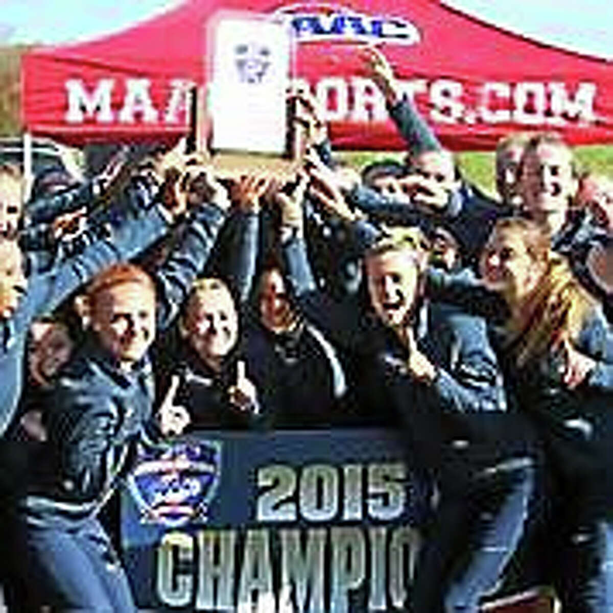 Members of the Quinnipiac women's cross country team celebrate after winning the MAAC championship on Oct. 31.