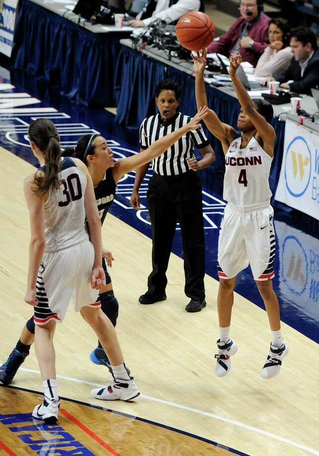 UConn's Moriah Jefferson, right, shoots a 3-point basket against Vanguard's Maya Kennedy as Breanna Stewart, left, defends during the second half Sunday. Photo: Jessica Hill — The Associated Press   / FR125654 AP