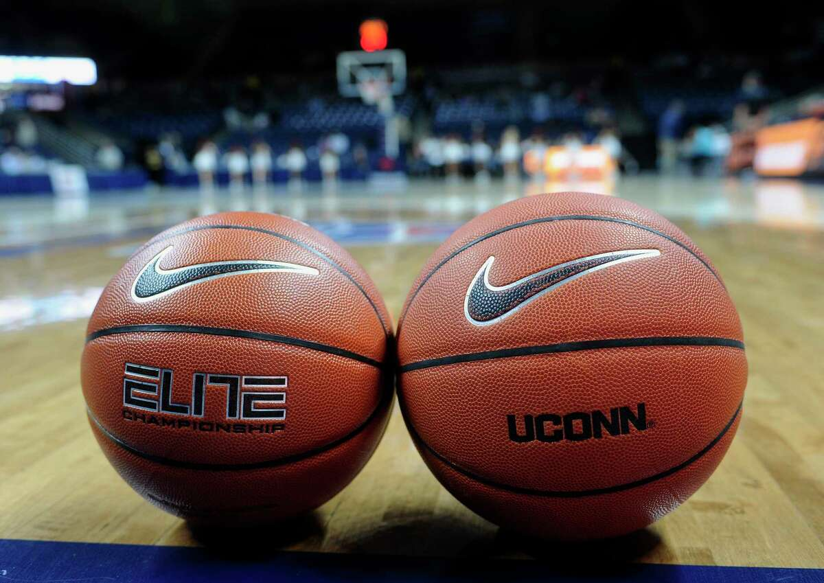 A women's college basketball, left, and men's college basketball are displayed before Sunday's game. The men's basketball was used in Sunday's game.