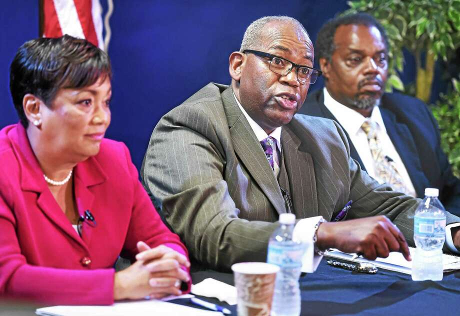 Former New Haven City Clerk Ron Smith, center, makes a point during a mayoral debate at Citizens Television in New Haven Monday. At left is New Haven Mayor Toni Harp and at right is mayoral candidate Sundiata Keitazulu. Photo: Arnold Gold — New Haven Register