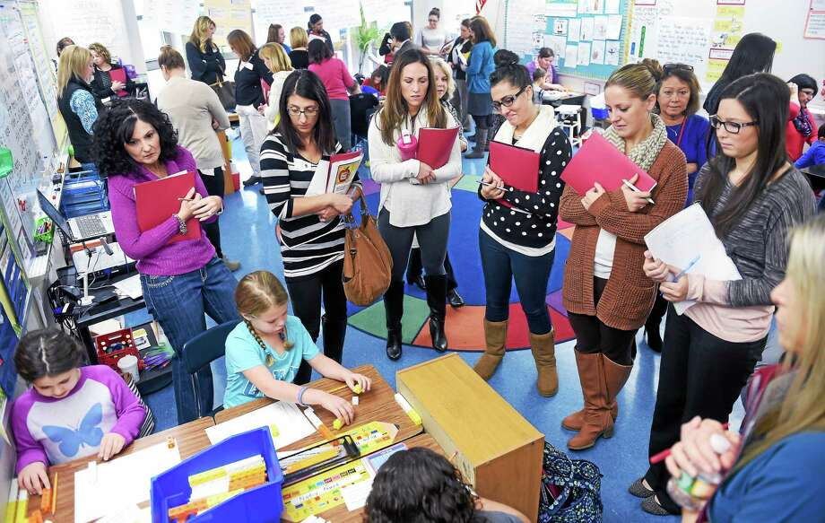 Area teachers observe second graders Carolina Lippolis (far left), 8, and Kayla Nugent (left), 7, in a math class at Mary T. Murphy Elementary School in Branford during a lesson study program Wednesday. Photo: (Arnold Gold-New Haven Register)