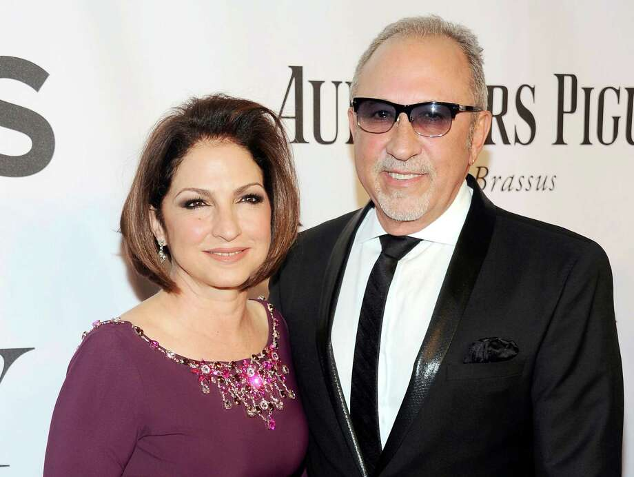 """In this June 8, 2014 photo, Gloria Estefan, left, and Emilio Estefan pose for photos at the 68th annual Tony Awards at Radio City Music Hall in New York. Gloria Estefan and her husband, Emilio, are shepherding their musical biography """"On Your Feet!"""" to Broadway this fall, celebrating two Cuban-Americans who embraced the American Dream and now own enough Grammy Awards to fill a house. Photo: Photo By Charles Sykes/Invision/AP, File   / Invision"""