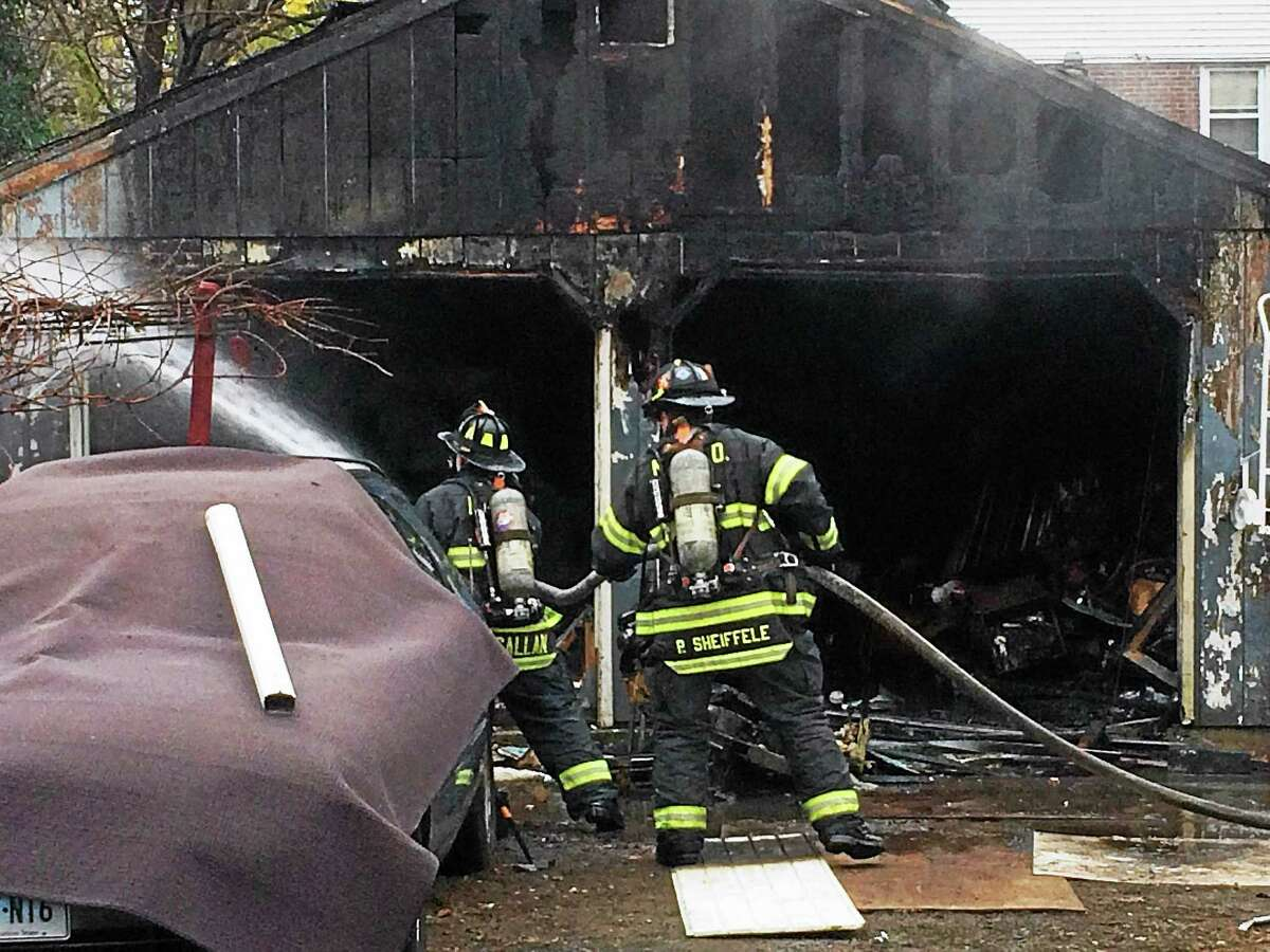 A fire severely damaged a detached garage at 260 Edgewood Ave. in New Haven early Wednesday afternoon. Firefighters were able to bring it under control quickly and a rabbit and chicken behind the garage were unharmed.
