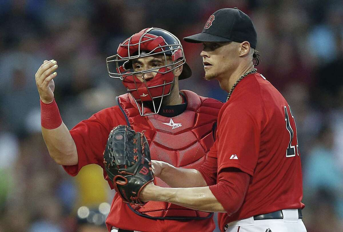 Red Sox catcher Sandy Leon, left, signals to the dugout beside Clay Buchholz during the fourth inning Friday against the New York Yankees in Boston.