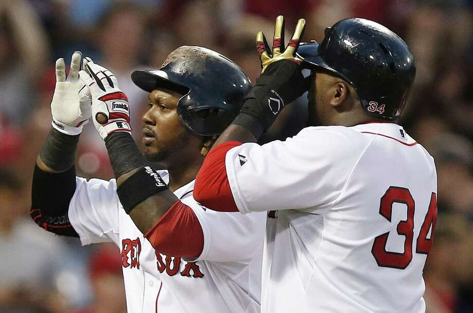 Hanley Ramirez, left, celebrates his two-run home run, that also drove in David Ortiz, during the fourth inning on Saturday. Photo: Michael Dwyer — The Associated Press   / AP