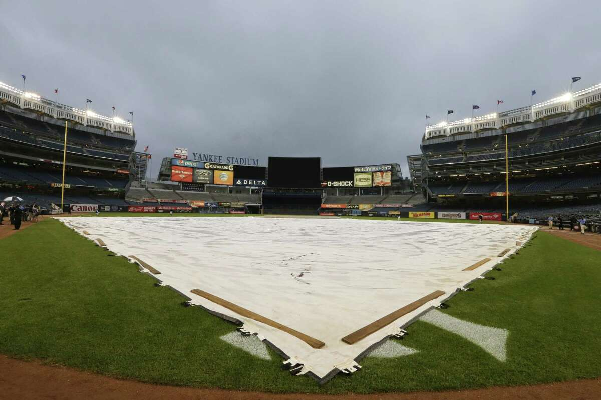 A tarp covers the field at Yankee Stadium as Thursday's game against the Toronto Blue Jays was postponed.