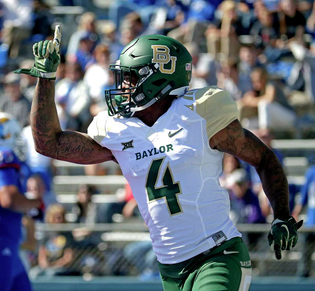 Baylor cornerback Xavien Howard celebrates after recovering a Kansas fumble and running the ball in for a touchdown during the first half Saturday.