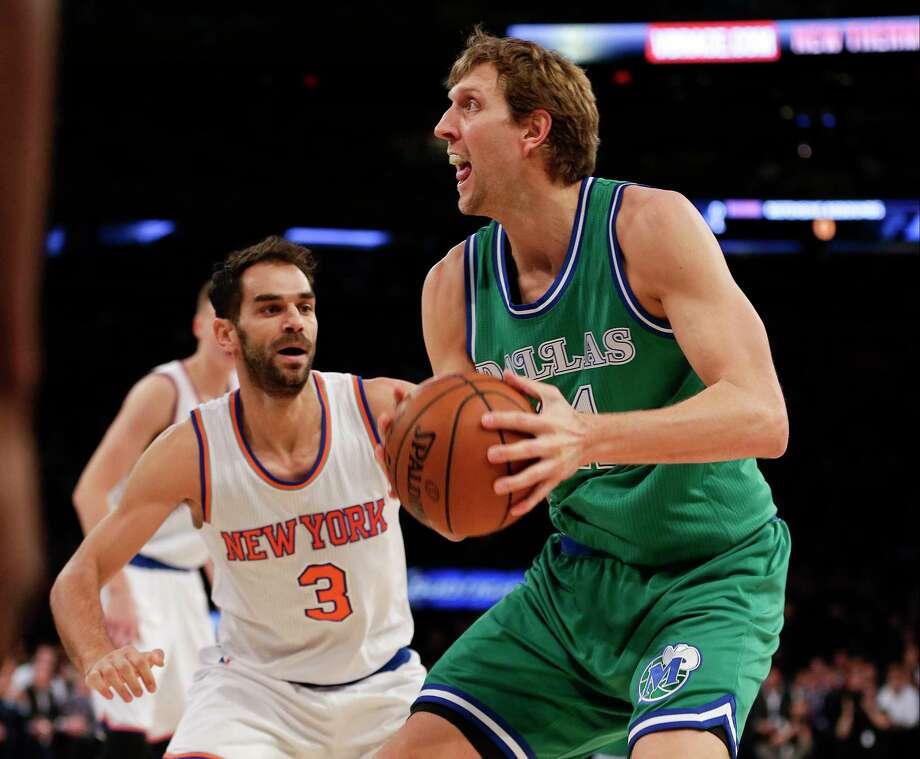 The Knicks' Jose Calderon defends the Mavericks' Dirk Nowitzki during Monday's game in New York. Photo: Frank Franklin II — The Associated Press   / AP