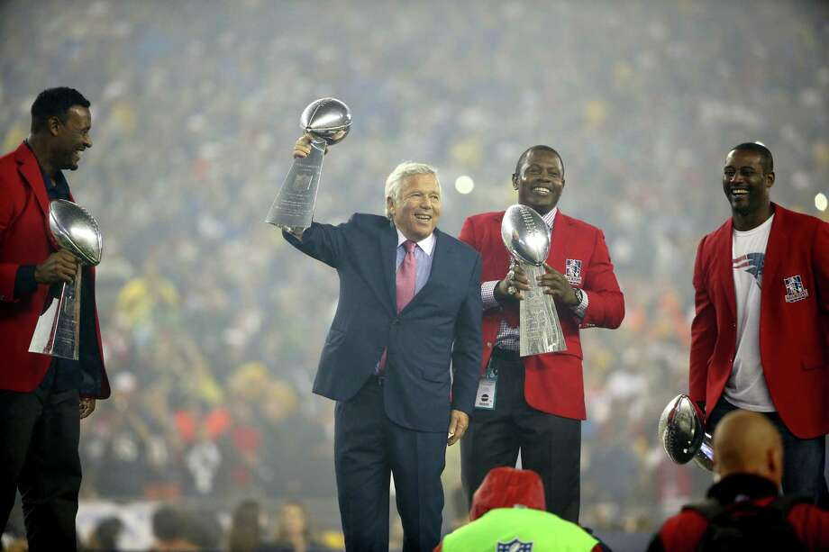 Patriots owner Robert Kraft, center, hoists the Lombardi Trophy for his team's win of Super Bowl XLIX as Patriots veterans hold the team's other three Lombardi trophies before Thursday's game against the Steelers. Photo: Winslow Townson — The Associated Press   / FR170221 AP