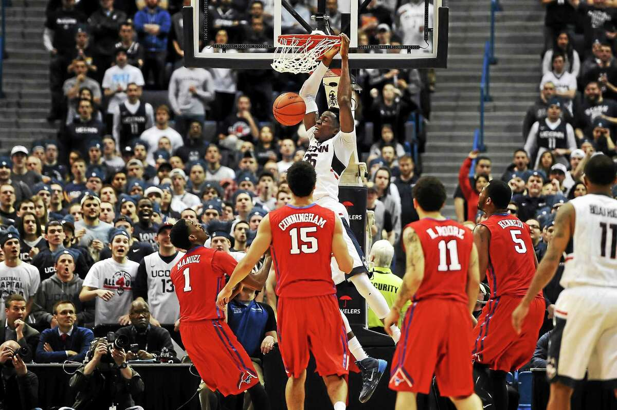 UConn's Amida Brimah dunks the ball in front of SMU defenders during a March 1 game at the XL Center in Hartford.