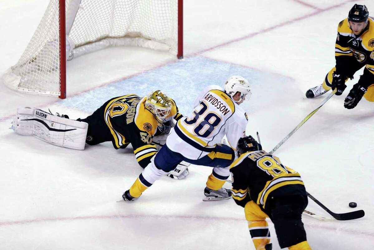 Nashville Predators right wing Viktor Arvidsson (38) eludes Boston Bruins goalie Jonas Gustavsson (50) as he sets up his goal during the third period of Monday's game.