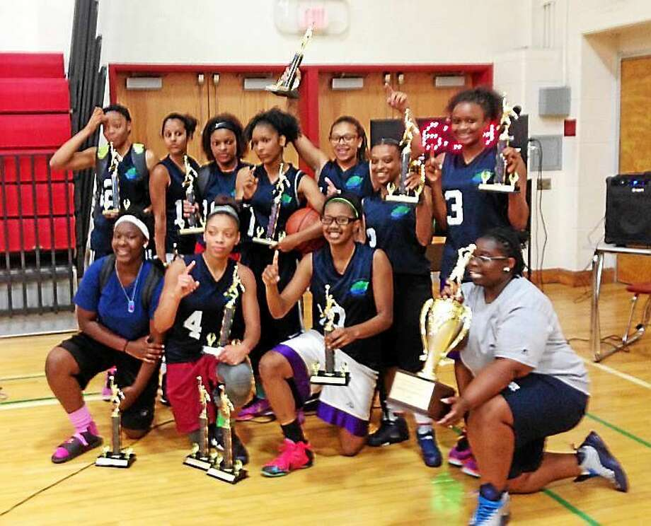 Hillhouse teammates pose with trophies after winning high school girls' title in the 34th season of the New Haven Parks & Recreation Summer League. Photo: Jim Fuller -- New Haven Register
