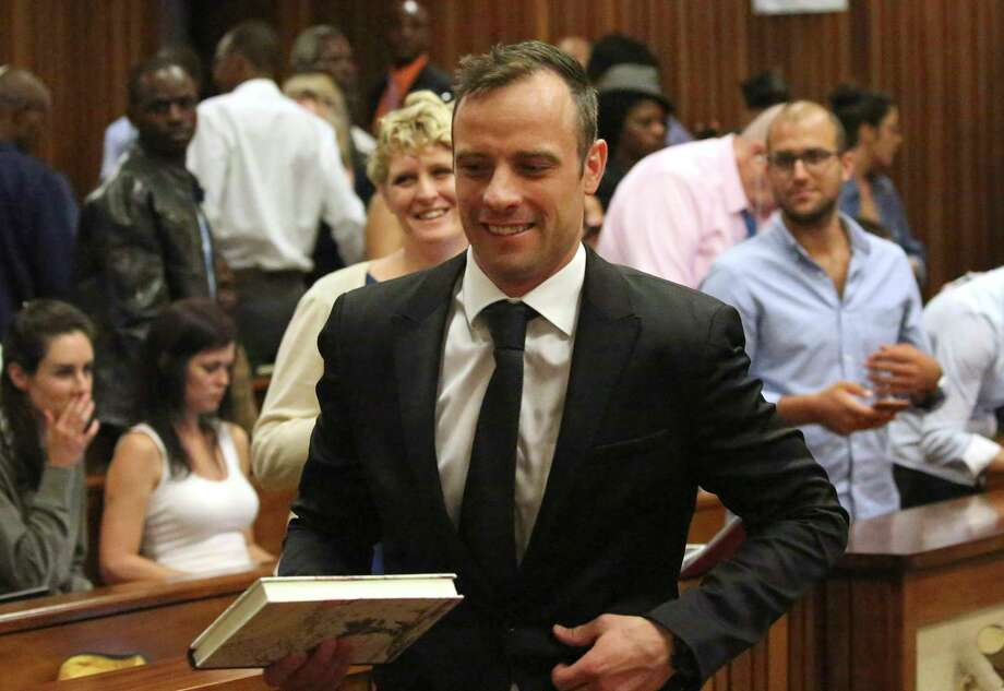 Oscar Pistorius leaves a courtroom of the High Court in Pretoria, South Africa, on Tuesday. Photo: Siphiwe Sibeko — The Associated Press   / Reuters POOL