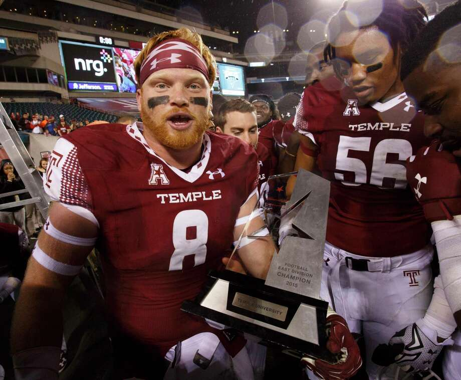6dbb5f2ee80 Temple linebacker Tyler Matakevich holds the AAC East Division trophy  following a 27-3 win