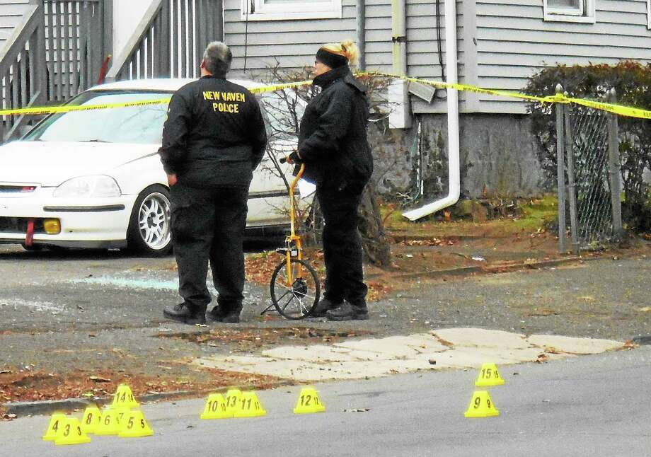 Part of Clinton Avenue in New Haven was shut down for hours Tuesday morning after a city man was fatally shot there. Photo: Wes Duplantier — New Haven Register