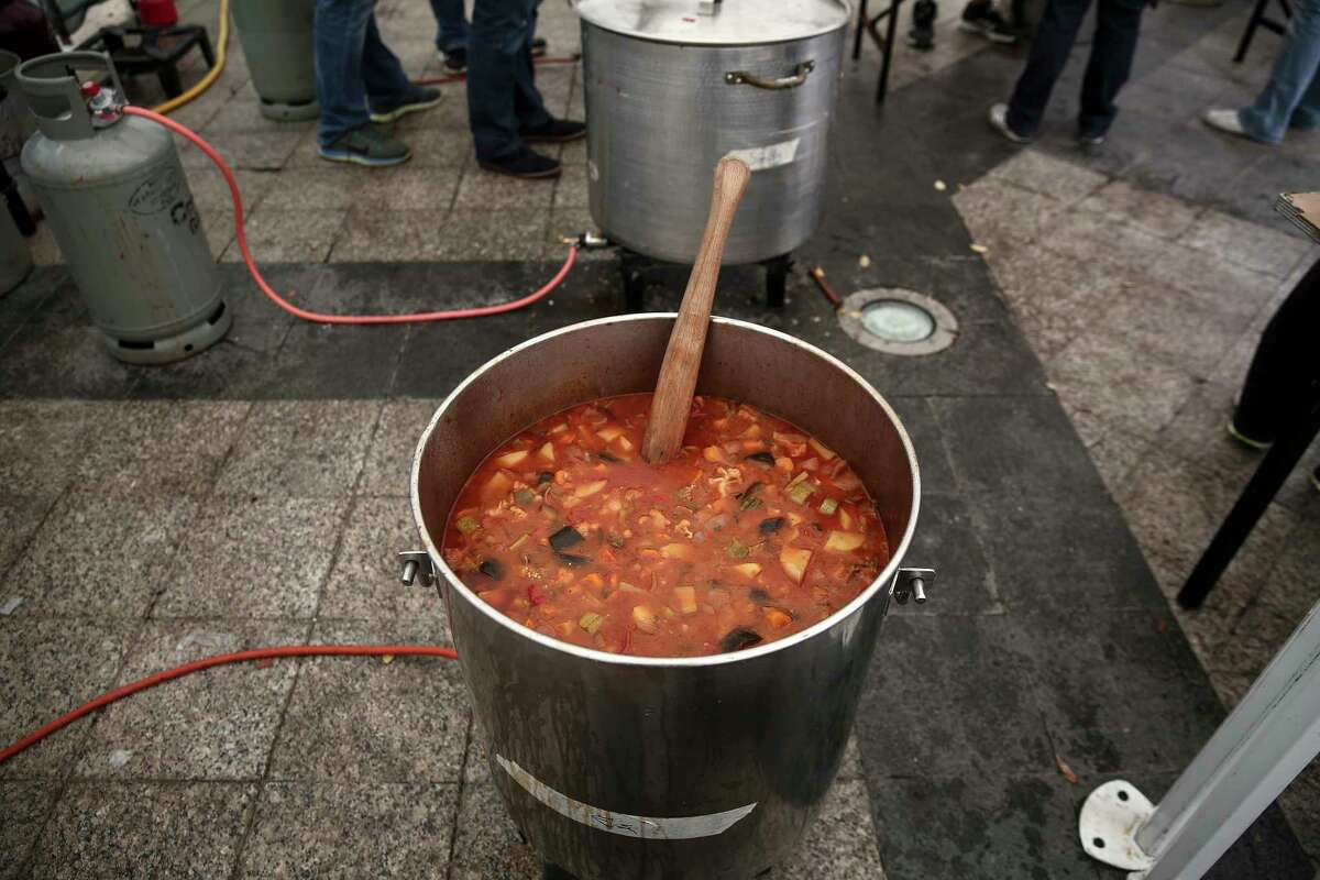 A cauldron with vegetable soup, made with 'wasted' produce deemed unsuitable by food stores because of their appearance, stands inside a tent during an event against food waste, in Athens, Greece on Oct. 11, 2015.