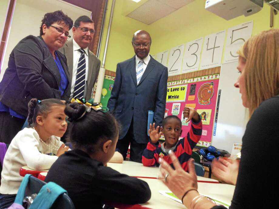 Mark Zaretsky -- NEW HAVEN REGISTER  West Haven Mayor Ed O'Brien (light suit) and Board of Education  members Rosa Richardson and Patrick Egolum check out the learning  in progress at one of the city's new all-day kindergarten classrooms in Washington School. Photo: Journal Register Co.