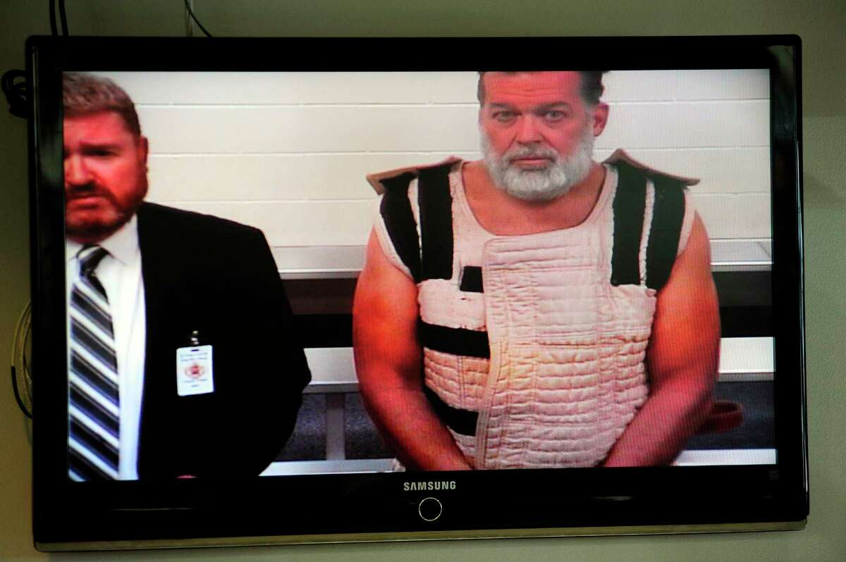 In this Monday, Nov. 30, 2015, file photo, Colorado Springs shooting suspect, Robert Dear, right, appears via video before Judge Gilbert Martinez, with public defender Dan King, left, at the El Paso County Criminal Justice Center for this first court appearance, where he was told he faces first degree murder charges in Colorado Springs, Colo. The man accused of killing multiple people at a Planned Parenthood clinic in Colorado asked at least one person in a nearby shopping center for directions to the facility before opening fire, a law enforcement official said.