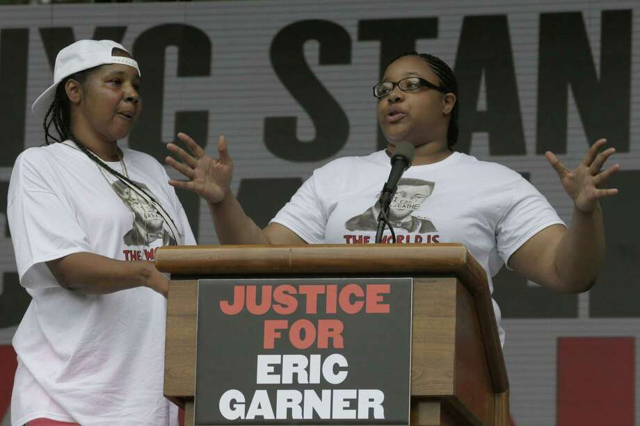 Eric Garner's daughter, Emerald Snipes, right, is joined by her mother, Esaw Snipes, as she speaks on stage during a rally in New York on July 18, 2015. Photo: AP Photo/Mary Altaffer   / AP