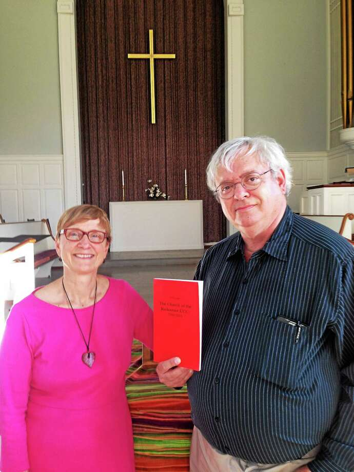 The Rev. Shelly Stackhouse, pastor of Church of the Redeemer in New Haven, with member Stefan Janis, author of a history of the parish since 1950. Photo: ED STANNARD — NEW HAVEN REGISTER