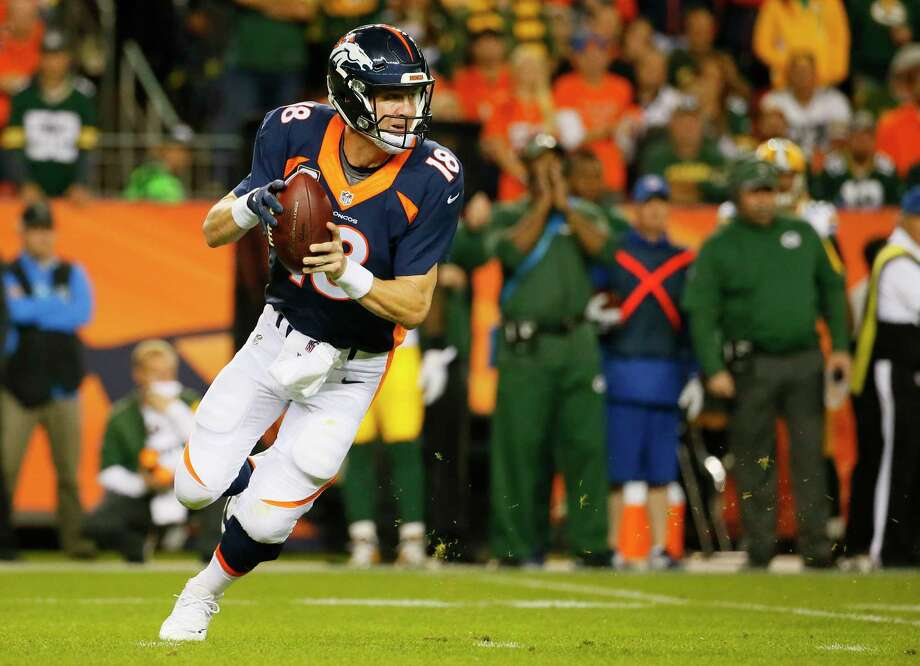 The Register's Dan Nowak is counting on Peyton Manning and the Broncos to cover against the Colts on Sunday. Photo: The Associated Press   / FR42408 AP