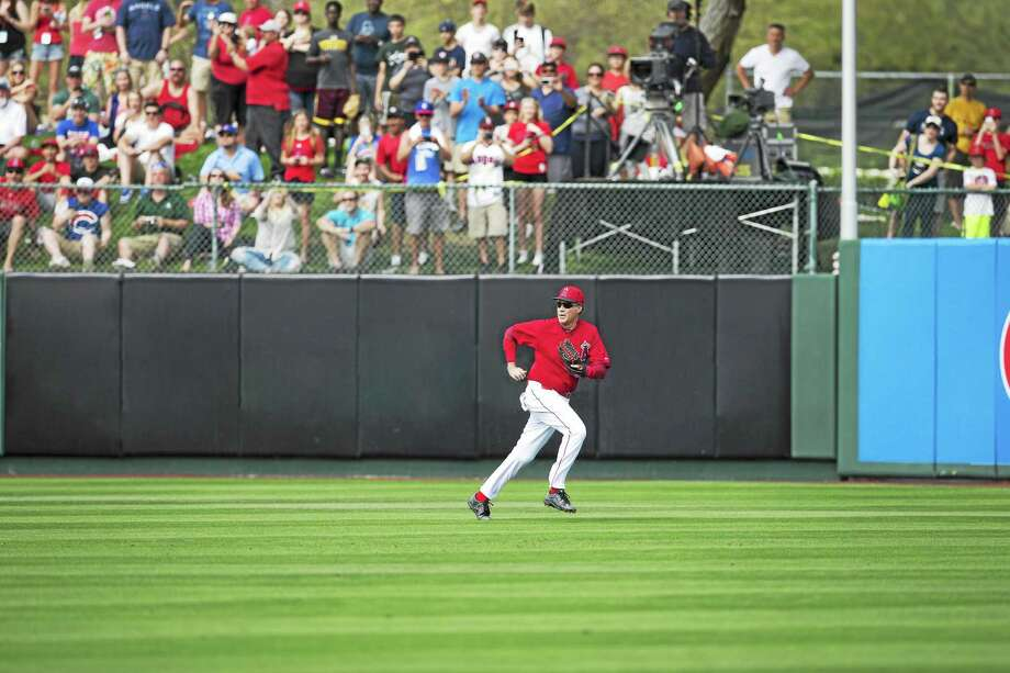 Will Ferrell moves to left-center to cleanly field a baseball during an MLB spring training game. Photo: HBO