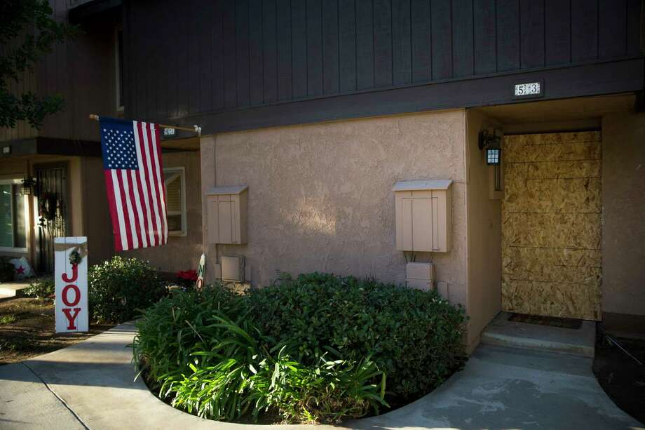 The Boarded up townhouse rented by the San Bernardino attackers Syed Farook and his wife, Tashfeen Malik, is seen right, Tuesday, Dec. 8, 2015, in Redlands, Calif. Just days before he carried out an attack that killed 14 people, Farook practiced with a rifle during one of several recent visits to a local shooting range, authorities said. Sometimes he was joined by his wife, his partner in the carnage. Photo: AP Photo/Jae C. Hong    / AP