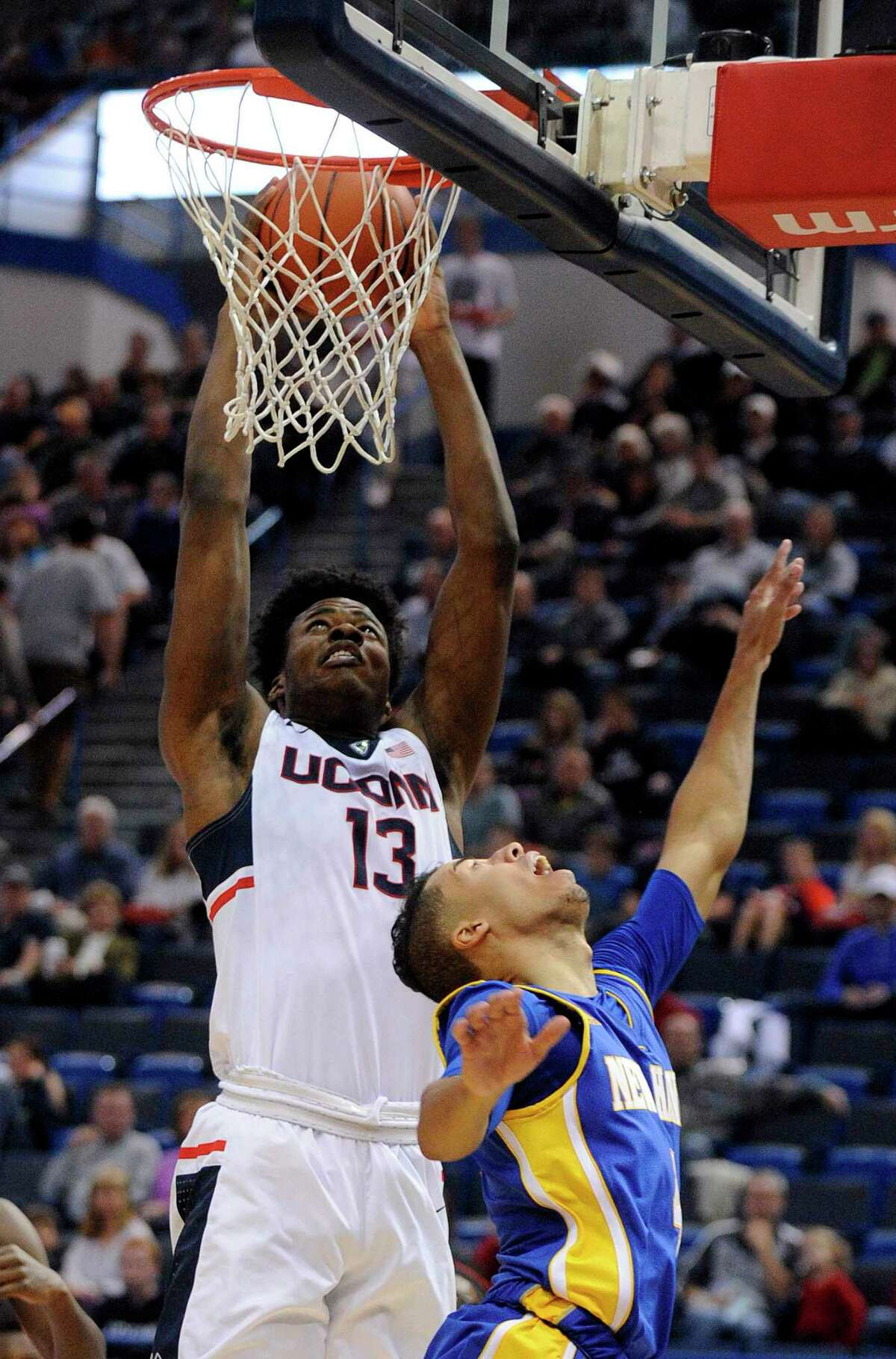 UConn's Steven Enoch (13) shoots over New Haven's Michael Bourke during the first half Saturday.