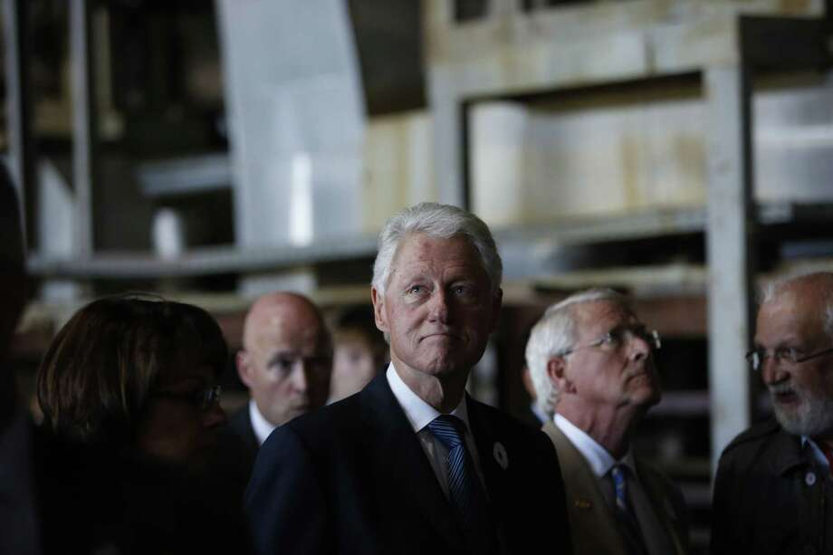 Former U.S. President Bill Clinton tours the former battery factory at Potocari memorial complex marking 20th anniversary of the Srebrenica massacre of Potocari, 150 kms northeast of Sarajevo,  Saturday, July 11, 2015. Twenty years ago, on July 11, 1995, Serb troops overran the eastern Bosnian Muslim enclave of Srebrenica and executed some 8,000 Muslim men and boys, which International courts have labeled as an act of genocide, and newly identified victims of the genocide are still being re-interred in Srebrenica. Photo: (AP Photo/Amel Emric) / AP