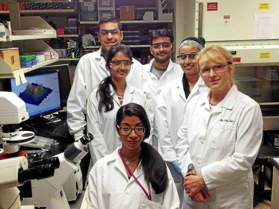 Mark Zaretsky - New Haven Register) University of New Haven Associate Professor Eva Sapi, at far right, who heads UNH's Lyme disease program, with five or her students in their lab on the school's West Haven campus. The students, clockwise from front left, are Kayla Socarron, Khusani Gupde, Jason Torres, Shafiq Shaikh and Rumanah Kasliwala. Photo: Journal Register Co.