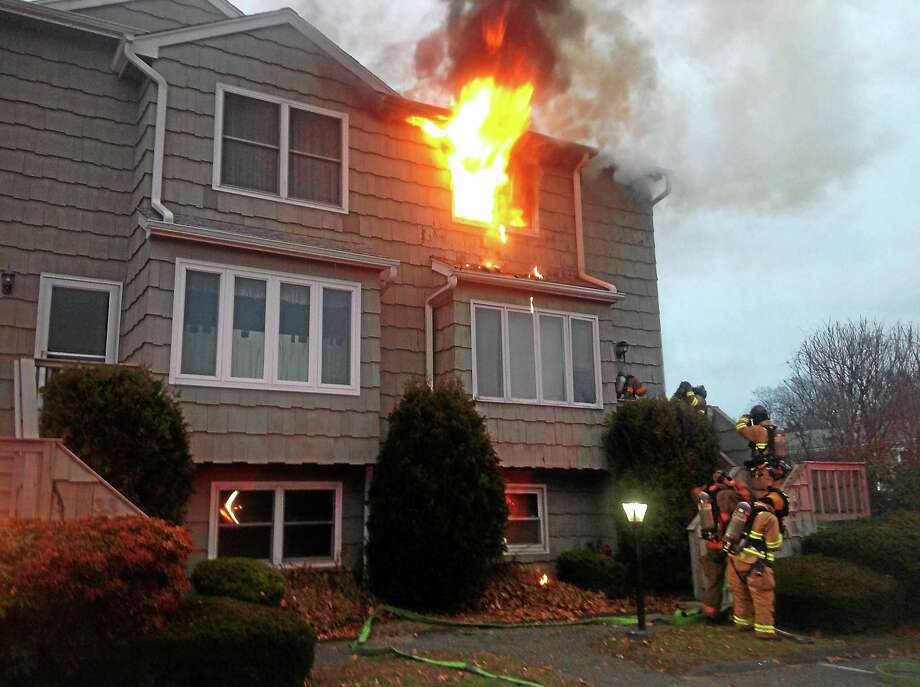A condominium on Southwind Lane in Milford was damaged when a fire broke out there Tuesday morning. Crews arrived to find fire coming out of one of the windows but were able to quickly put the flames out. Photo: Courtesy Of Milford Fire Department