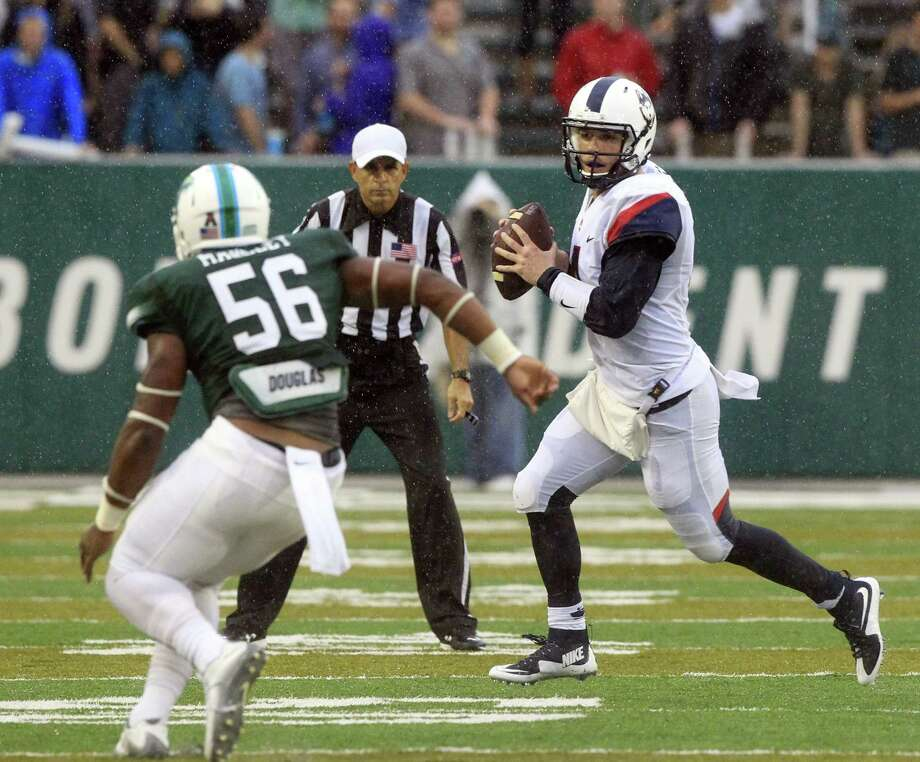 UConn quarterback Bryant Shirreffs (4) scrambles out of the pocket as Tulane linebacker Rae Juan Marbley (56) closes in during Saturday's game. Photo: A.J. Sisco — The Advocate Via AP   / The Advocate