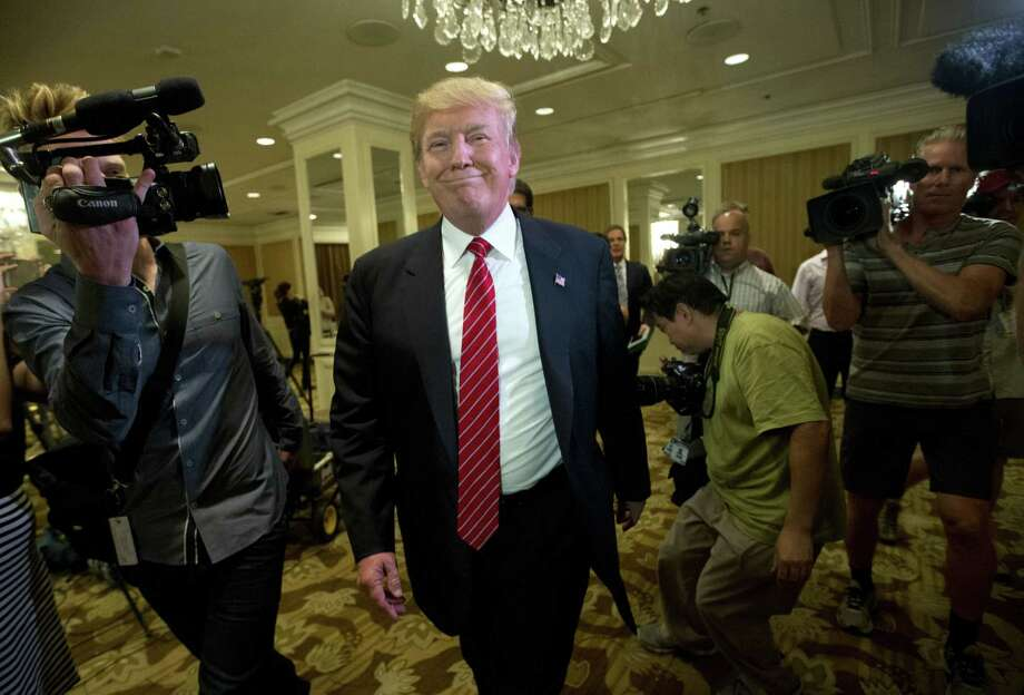 Republican presidential candidate Donald Trump smiles as he leaves after speaking at a news conference about immigration, Friday, July 10, 2015, in Beverly Hills, Calif. Photo: (AP Photo/Jae C. Hong) / AP
