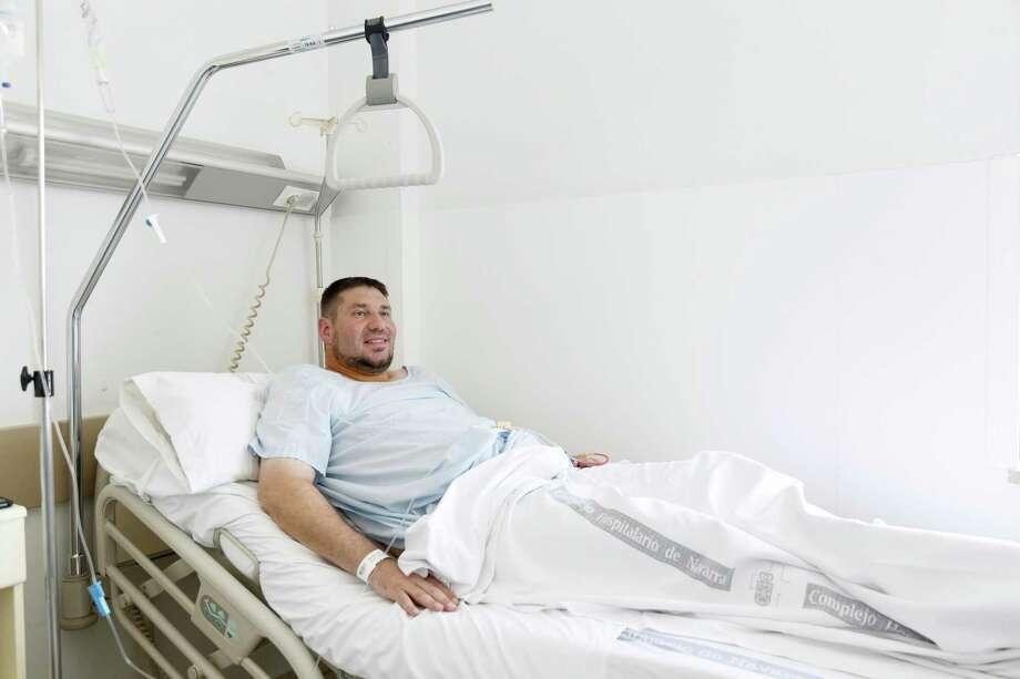 Mike Webster, a 38-year-old occupational therapist from Gainesville, Florida, USA, who was gored in the armpit while running with the bulls in Pamplona for his 38th time over the last 11 years, is pictured in hospital in Pamplona, Spain, Tuesday, July 7, 2015. Two Americans and a Briton were gored and eight others injured Tuesday as thousands of daredevils dashed alongside fighting bulls through the streets of this northern Spanish city on the first bull run of the San Fermin festival. (AP Photo/Daniel Ochoa de Olza) Photo: AP / AP