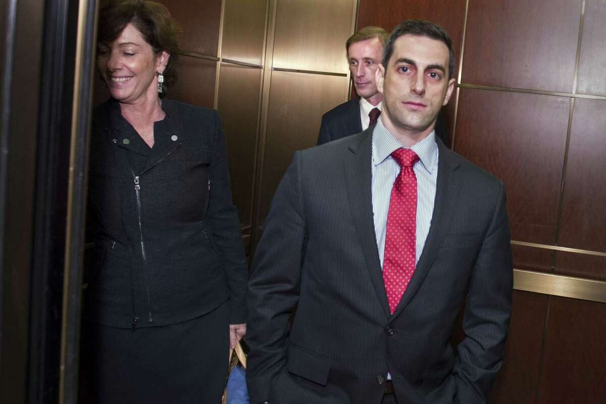 Former Hillary Clinton aide Jake Sullivan, center back, is flanked by his legal team as he boards an elevator on Capitol Hill in Washington, Friday, Sept. 4, 2015, following a day of testifying behind closed doors to the House committee investigating the deadly Benghazi attacks.