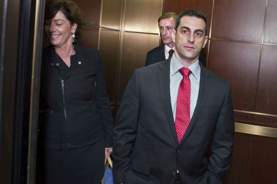 Former Hillary Clinton aide Jake Sullivan, center back, is flanked by his legal team as he boards an elevator on Capitol Hill in Washington, Friday, Sept. 4, 2015, following a day of testifying behind closed doors to the House committee investigating the deadly Benghazi attacks. Photo: AP Photo/Cliff Owen    / FR170079 AP
