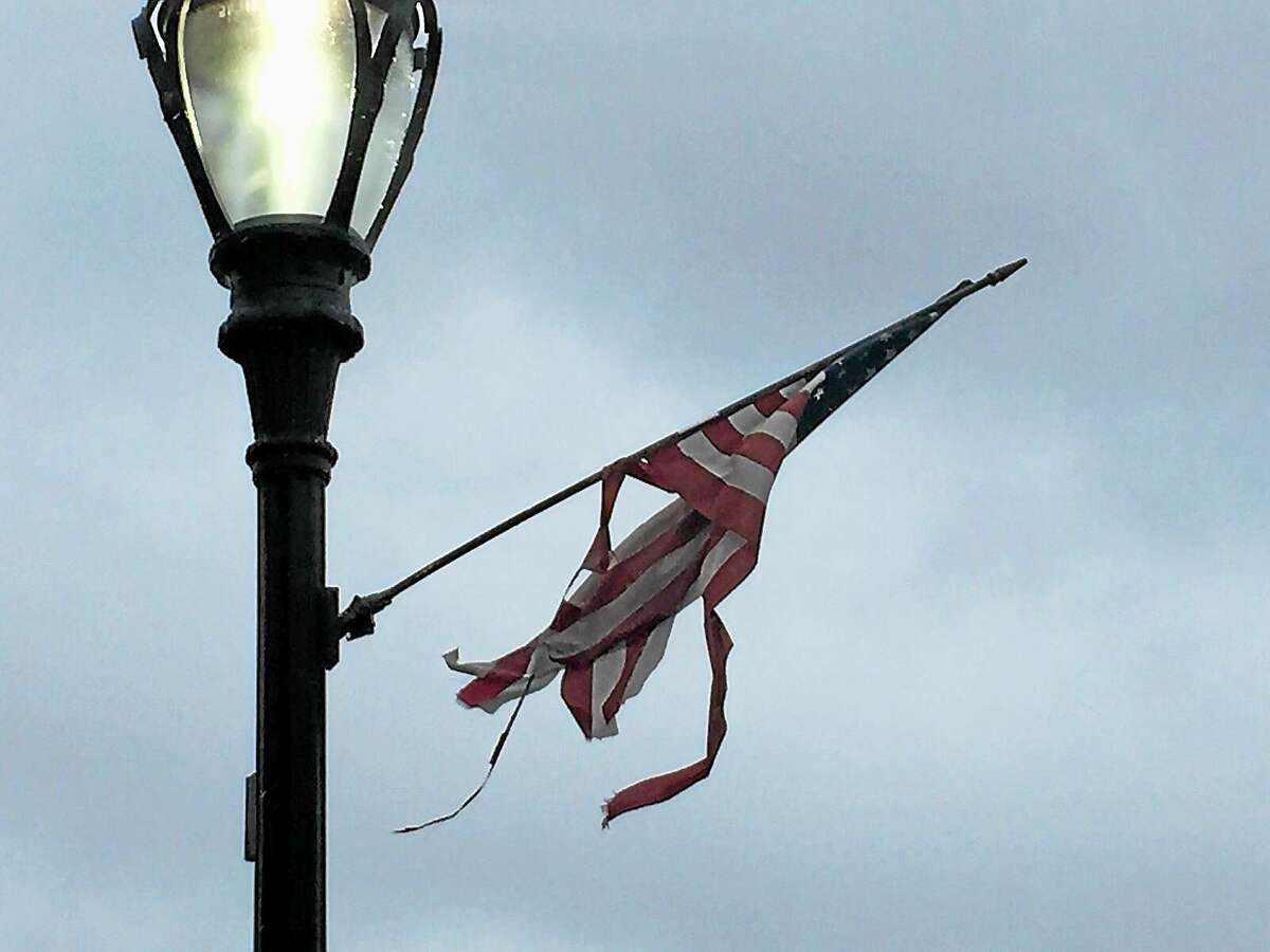 Most of the two dozen flags hanging from the black light posts that line Main Street are either tattered and torn, have broken sticks that have been pieced together with duct tape or are laying on the ground.