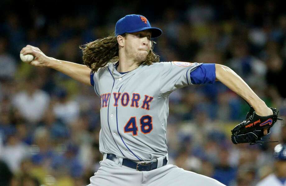 New York Mets starting pitcher Jacob deGrom throws against the Los Angeles Dodgers during the first inning in Game 1 of baseball's National League Division Series, Friday, Oct. 9, 2015 in Los Angeles. (AP Photo/Lenny Ignelzi) Photo: AP / AP