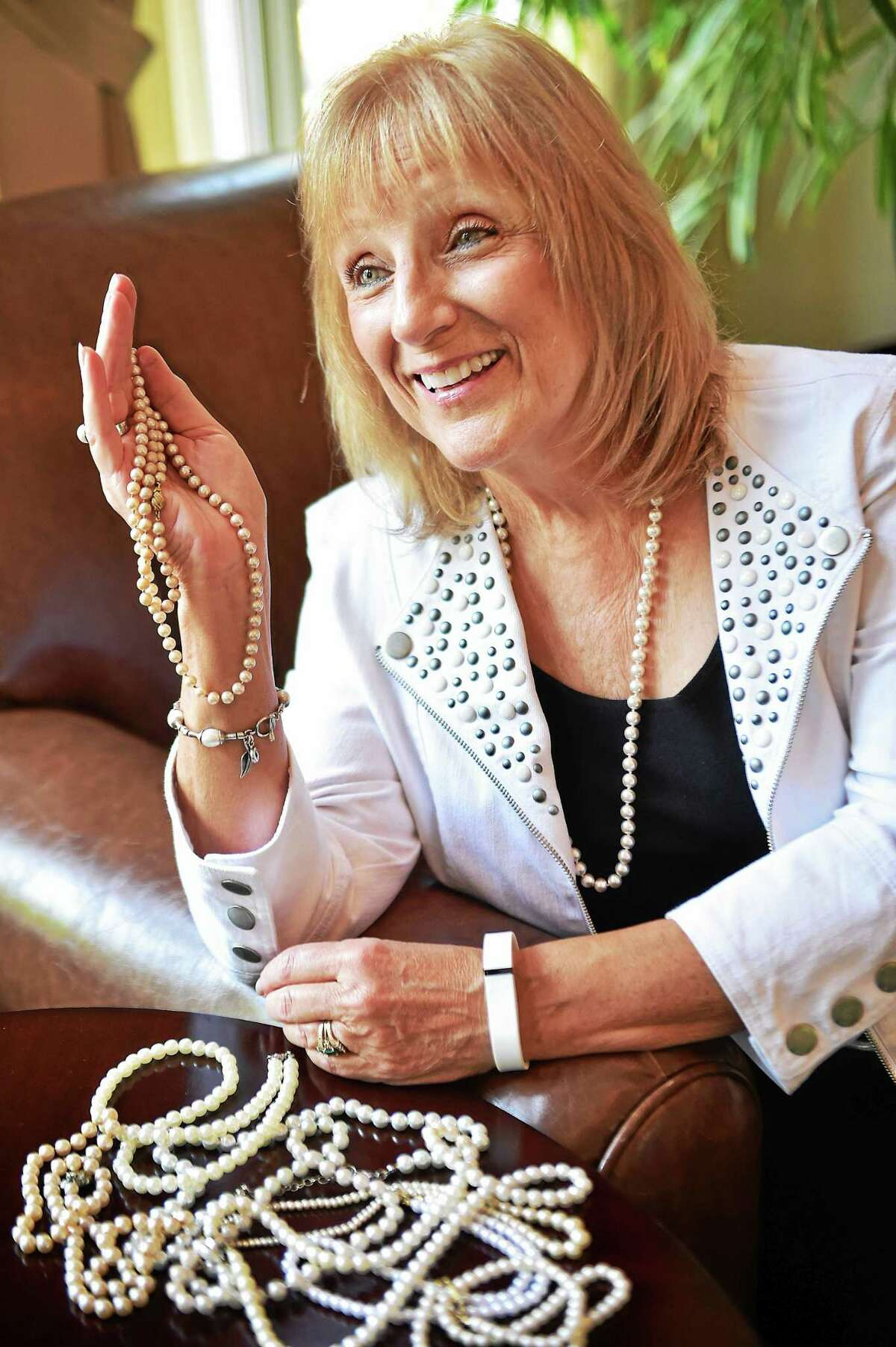 Eldercare specialist Jay Ayr, founder of Pearls to Girls and Caps to Chaps, is photographed at the Madison House at 34 Wildwood Avenue in Madison, Wednesday, July 1, 2015.
