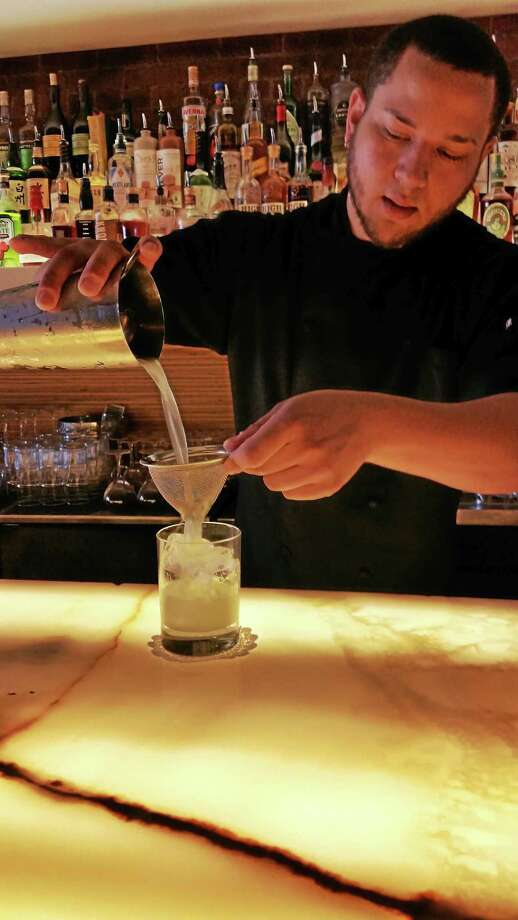 Bartender Greg Mills at 116 Crown pours a drink during Happy Hour. Photo: Jason C. Diaz - New Haven Register
