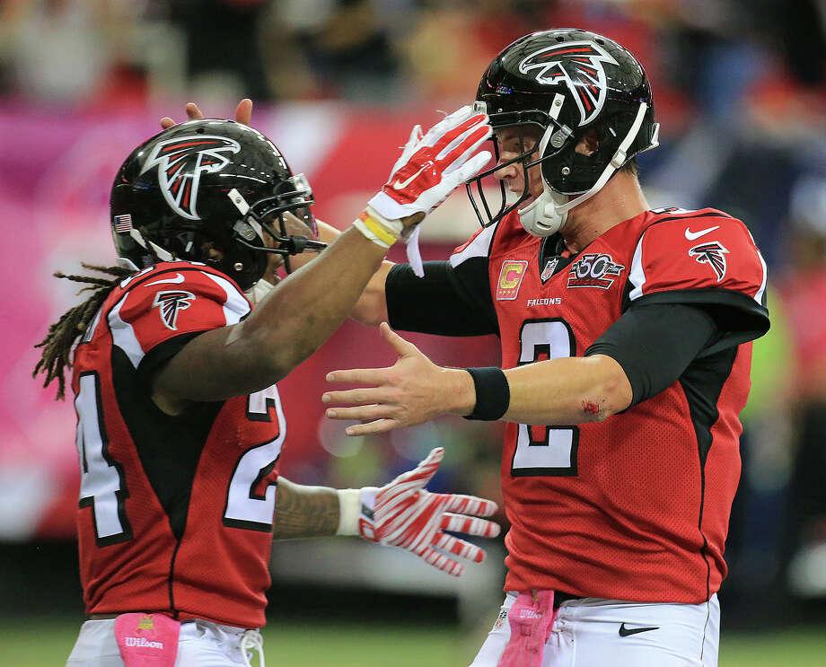 The Register's Dan Nowak likes Matt Ryan, right, Davanta Freeman and the Falcons to cover this week against Washington. Photo: The Associated Press File Photo   / Atlanta Journal & Constitution